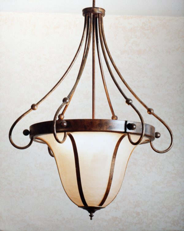 Elegant pendant chandeliers made of slumped art glass and faux bronze elements.