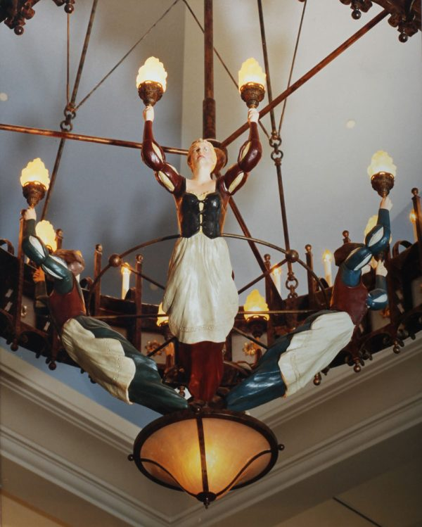 A detailed shot of the half life sized handmaidens that adorn the large chandeliers in the lobby.